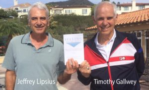 Jeffrey Lipsius and Timothy Gallwey holding up Selling To The Point book