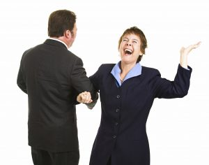 Male and femal business partner dancing around joyfully as their business is saved. Isolated on white.